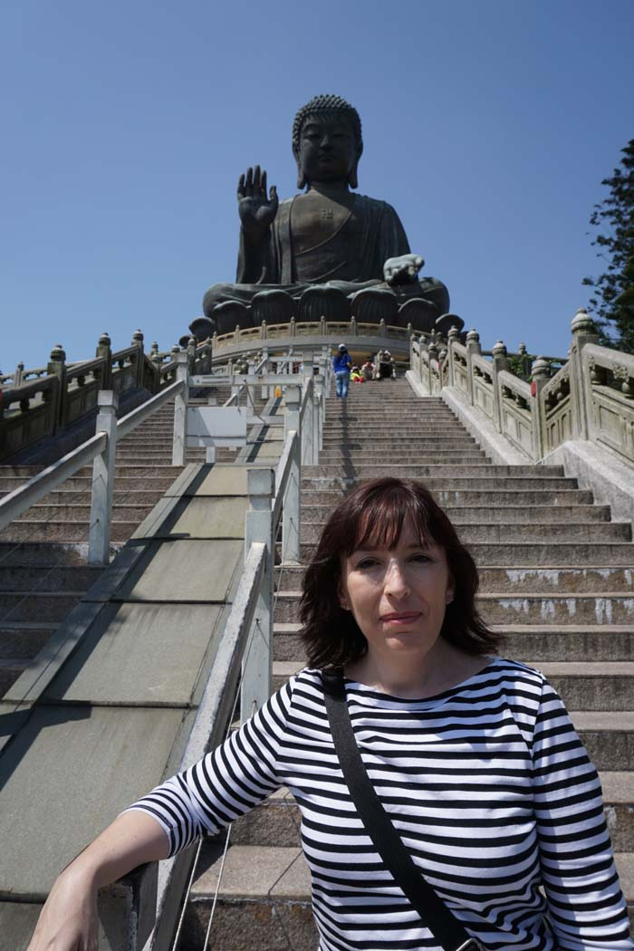 Kristina in front of Tian Tan Buddha