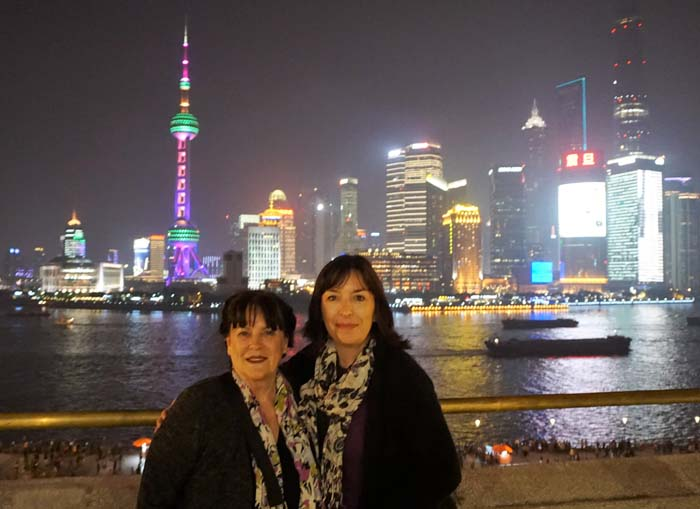 Us in front of the view from the Bund