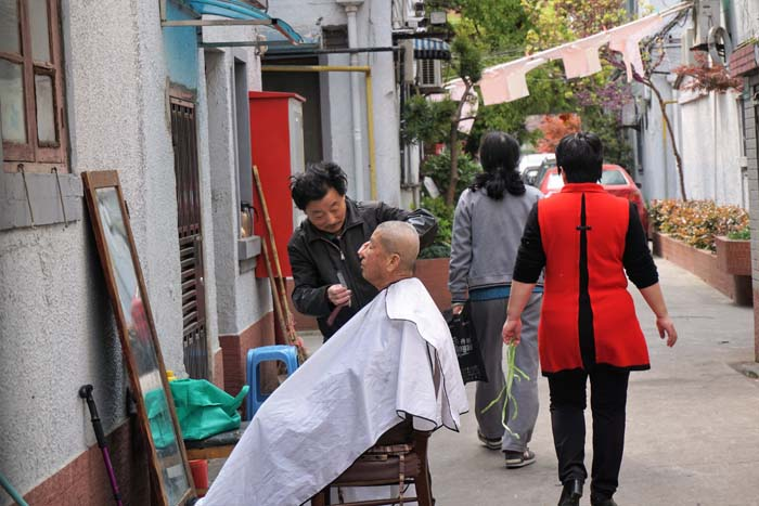 Shanghai street life; the street barber